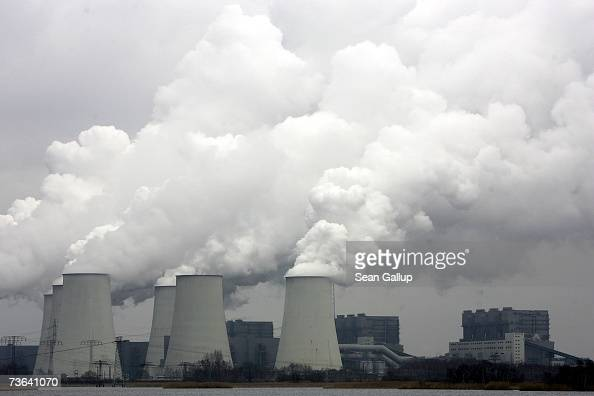 Exhaust plumes from cooling towers at the Jaenschwalde lignite coalfired power station March 20 2007 at Jaenschwalde Germany Though Germany has been...