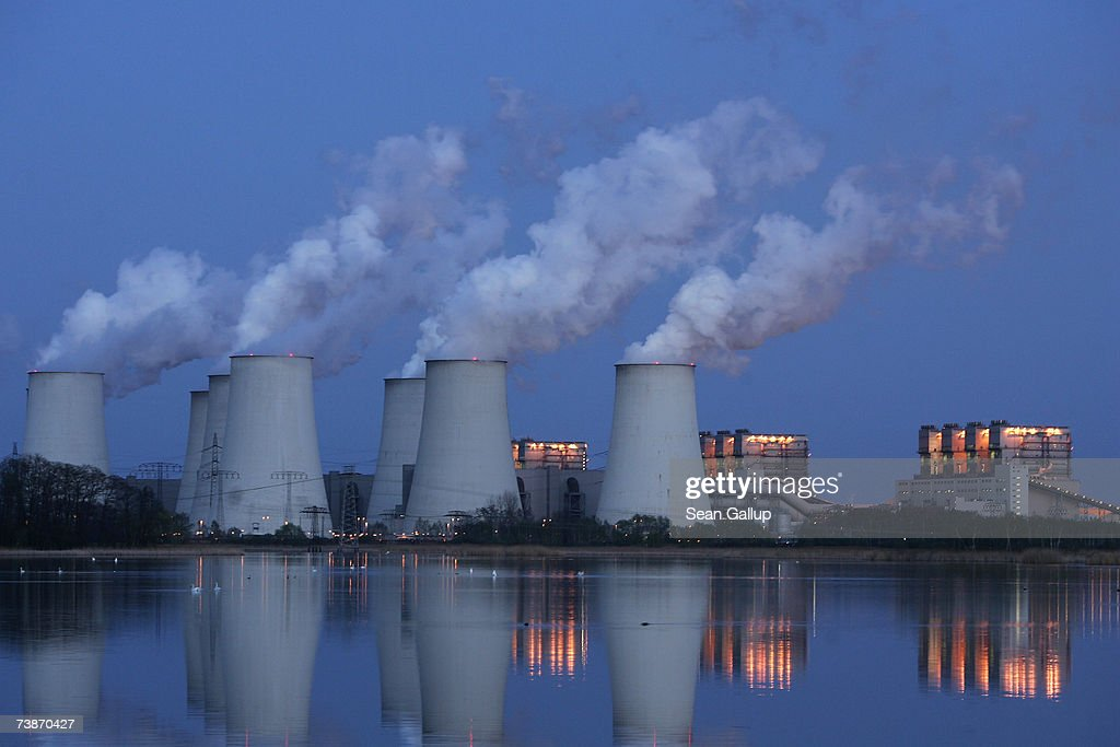 Exhaust plumes from cooling towers at the Jaenschwalde lignite coalfired power station which is owned by Vatenfall April 12 2007 at Jaenschwalde...