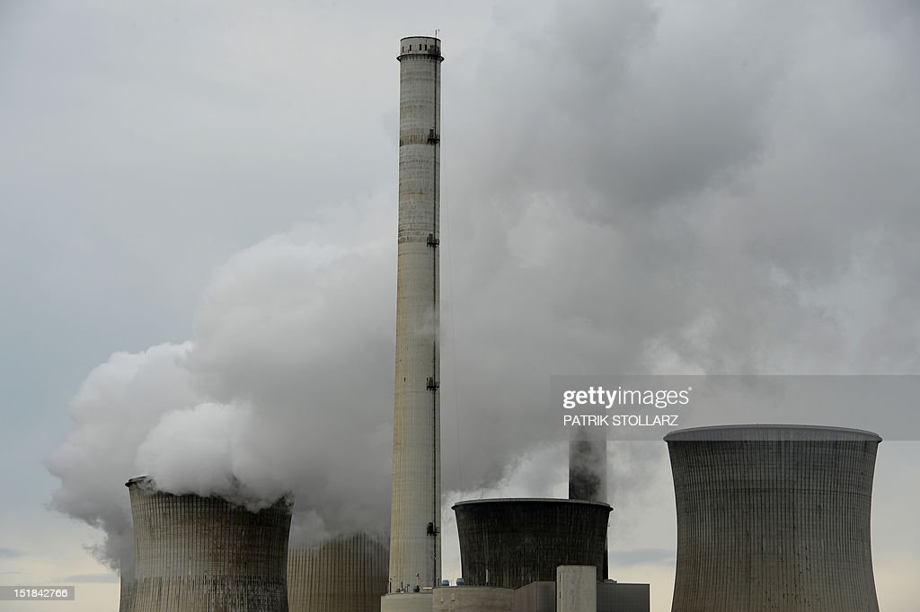 Exhaust rises from cooling towers at the new Neurath lignit coal-fired power station on September 11, 2012 at Grevenbroich near Aachen, western Germany. RWE, one of Germany's major energy provider, invested in new coal conducted power plants.