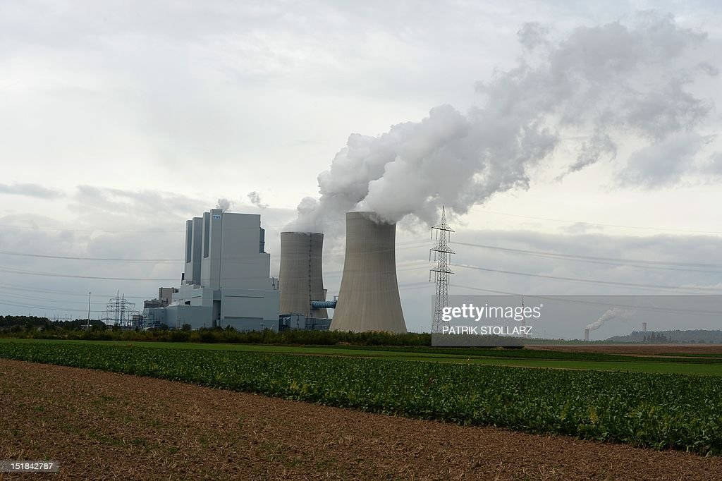 Exhaust rises from cooling towers at the new Neurath lignit coal-fired power station on September 11, 2012 at Grevenbroich near Aachen, western Germany. RWE, one of Germany's major energy provider, invested in new coal conducted power plants. AFP PHOTO / PATRIK STOLLARZ