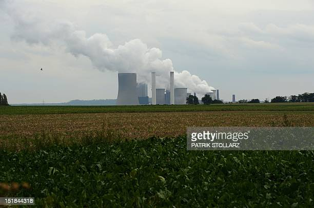 Exhaust rises from cooling towers of the new Neurath lignit coalfired RWE power station on September 11 2012 at Grevenbroich near Aachen western...