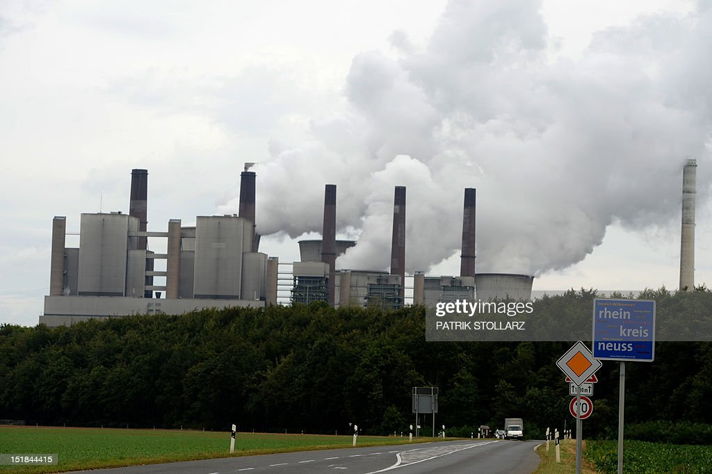 Exhaust rises from cooling towers of the new Neurath lignit coal-fired RWE power station on September 11, 2012 at Grevenbroich near Aachen, western Germany. RWE, one of Germany's major energy provider, invested in new coal conducted power plants.