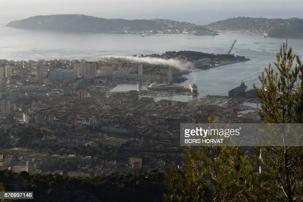 Exhaust smoke coming from Corsica Ferries' company hovers above Toulon harbour on November 21 2017 / AFP PHOTO / BORIS HORVAT