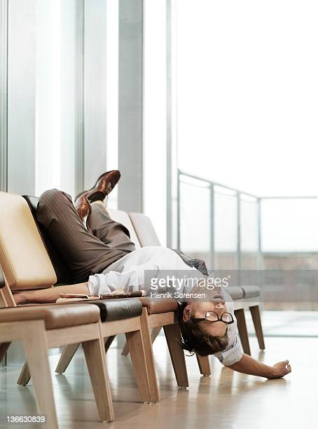 exhausted business man in waiting lounge