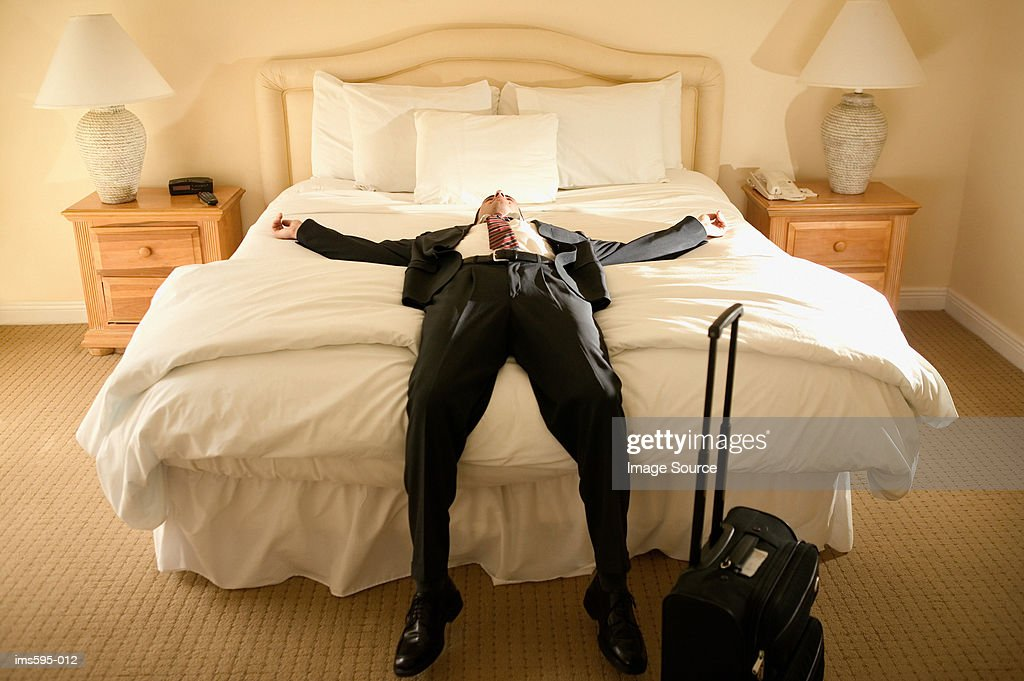 Exhausted businessman on bed