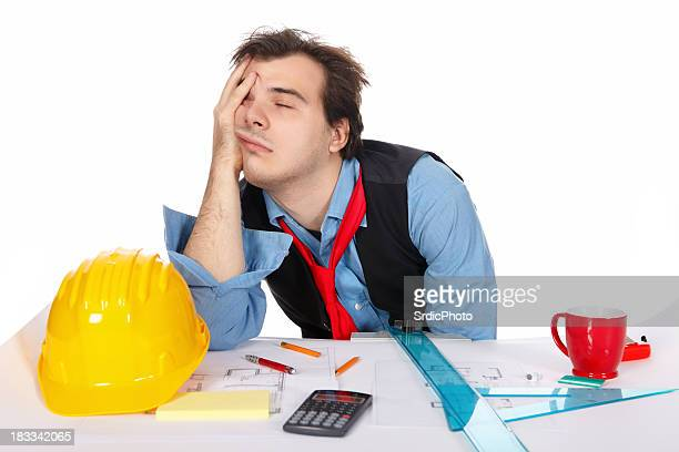 Exhausted businessman sleeping at his office isolated on white background