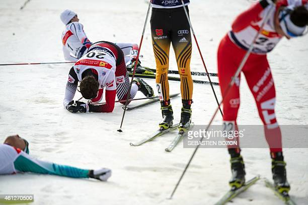 Exhausted competitors cross the finish line during the individual Gundersen of the FIS Nordic Combined World Cup on January 10 2015 in ChauxNeuve...