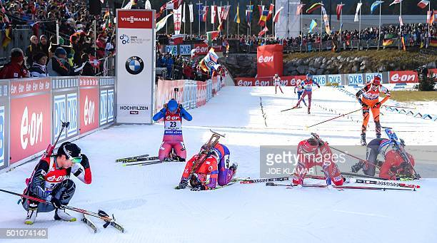Exhausted competitors rest in the finish area after crossing finish line during the women's 10 km pursuit event during IBU World Cup in biathlon in...