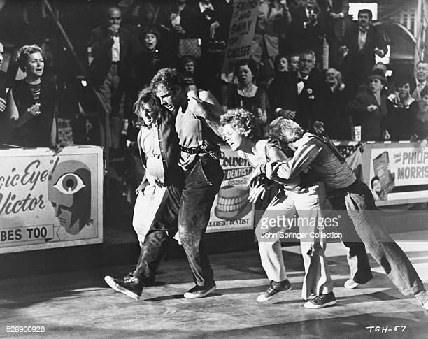Exhausted dancers in a scene from the 1969 film They Shoot Horses Don't They The main actors in this scene are Bonnie Bedelia as Ruby Bruce Dern as...