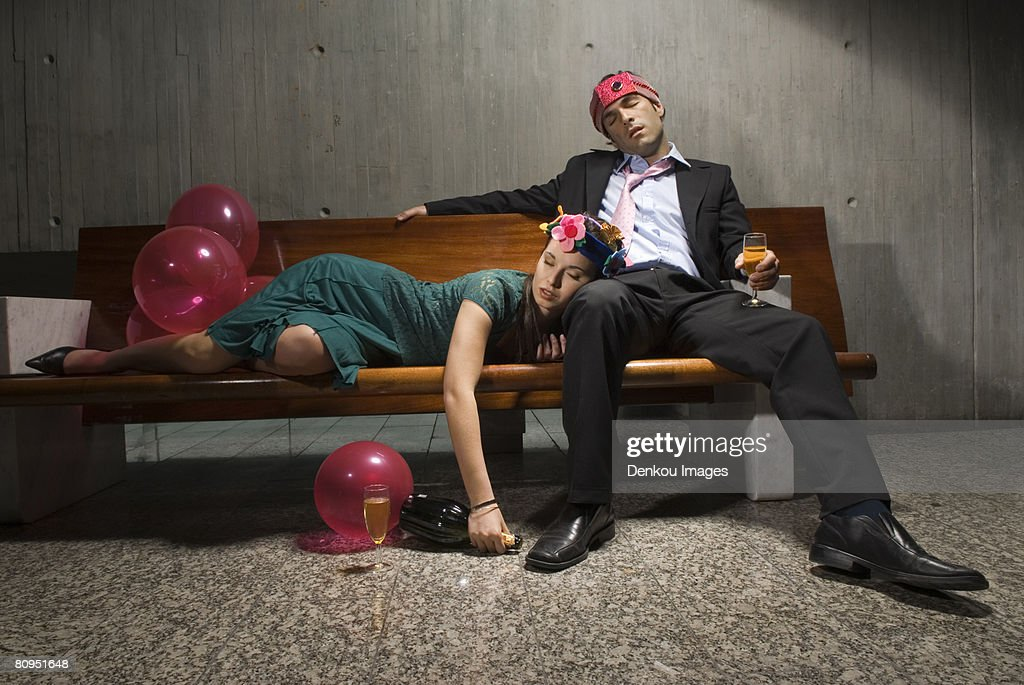 Exhausted drunk couple passed out from partying : Stock Photo