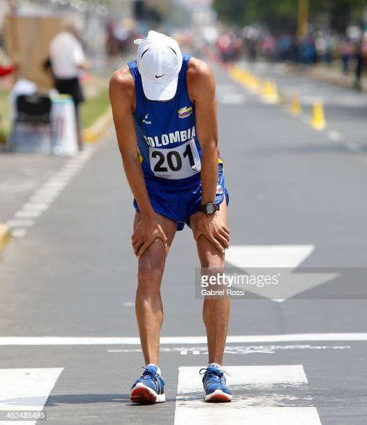 Exhausted Ferney Rojas of Colombia crosses the finish line in 50k walk race as part of the XVII Bolivarian Games Trujillo 2013 at Juan Pablo Street...