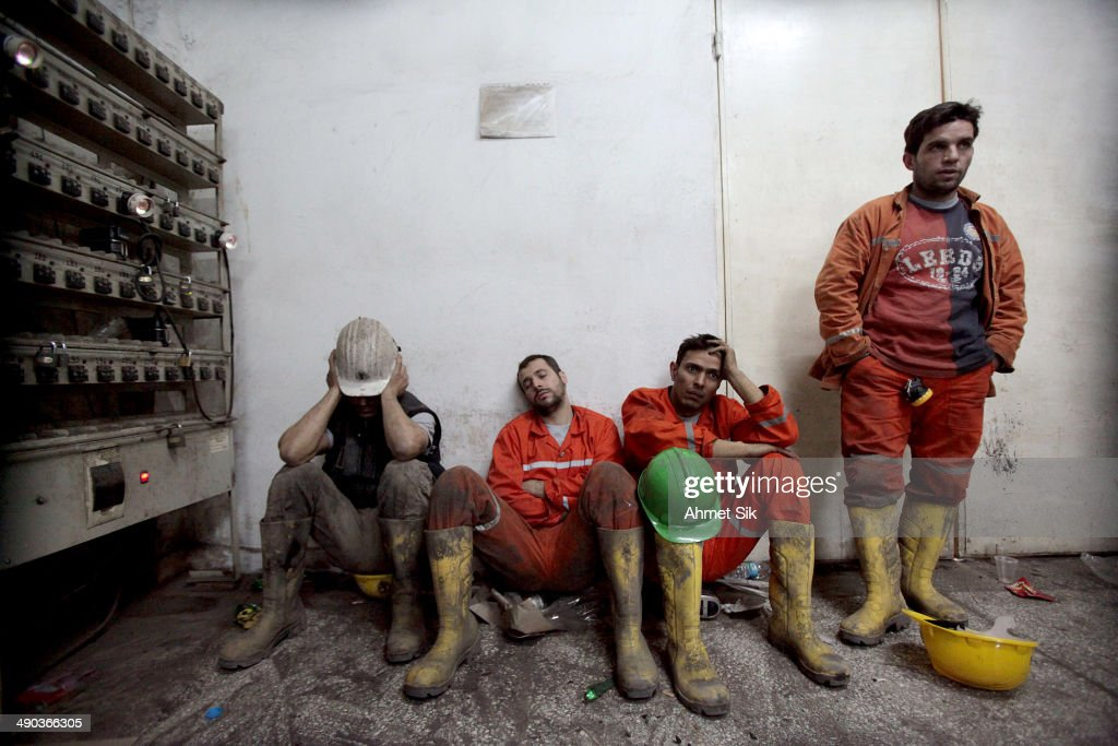 Exhausted miners rest as they await their trapped friends on May 14 2014 in Soma Turkey Rescuers pulled more dead and injured from the coal mine in...