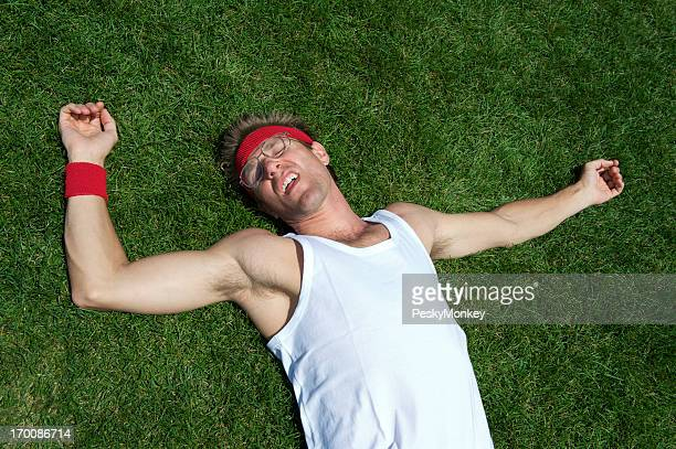 Exhausted Nerd Athlete Lies Passed Out in Grass