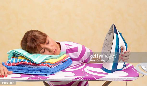 Exhausted woman on ironing board