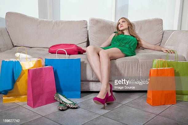 Exhausted young woman with shopping bags