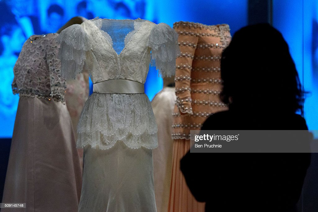 A exhibition assistant looks at a Bruce Oldfield dress that was worn by Princess Diana is displayed at the Fashion Rules Exhibition at Kensington Palace on February 9, 2016 in London, England. The exhibition, that re-opens to the public on February 11 contains pieces including the dress Queen Elizabeth II wore for her official Silver Jubilee photograph and a dress worn by Diana, Princess of Wales for her last official photo shoot with famed photographer Mario Testino