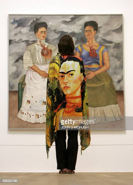 Exhibition curator Emma Dexter stands in front of 'The Two Fridas' part of the Frida Kahlo exhibition at the Tate Modern in London 07 June 2005 It is...