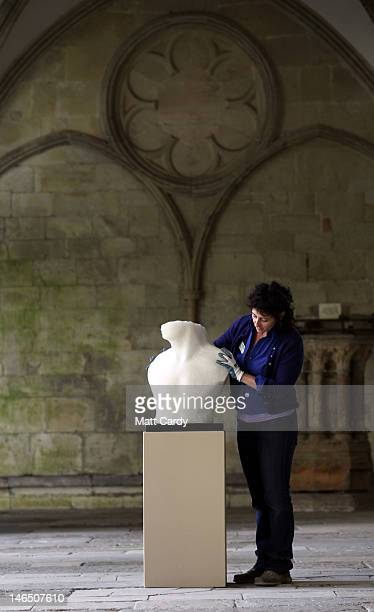 Exhibition curator Jacquiline Creswell moves Ben Dearnley sculpture of Lee Pearson in the Avenue of Champions he has created in the west cloister of...