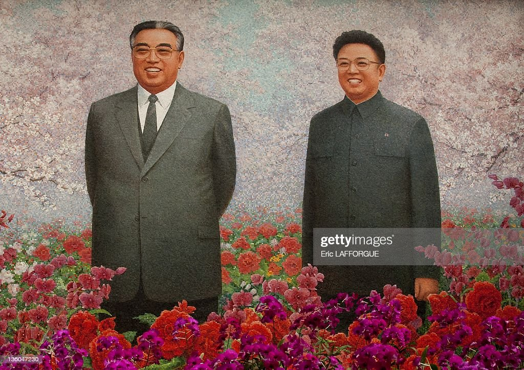 Exhibition for the Presidents' birthdays, the two leaders, Kim Il Sung and Kim Jong Il on a giant fresco on April 25, 2010 in Pyongyang, North Korea. The flowers exhibited in this hall are the Kimilsungias and the Kimjongilias. These breeds of orchid are named after the two leaders of