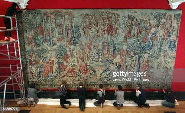 Exhibition staff hang a 8m x 4m tapestry entitled Peace and Mercy Win the Promise of Redemption as part of The Northern Renaissance Drer to Holbein...