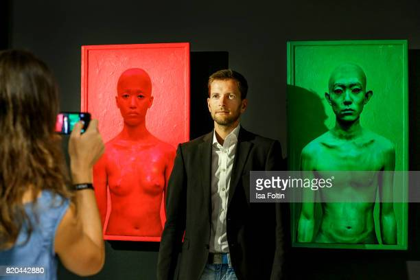 Exhibition visitors take pictures of 'Body Pain' of artist Exonemo during the 'Ars Electronica' Group Exhibition and 'Dritte Landschaft/Third...