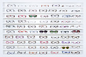 exhibitor of glasses consisting of shelves of fashionable glasses shown on a wall at the optical shop