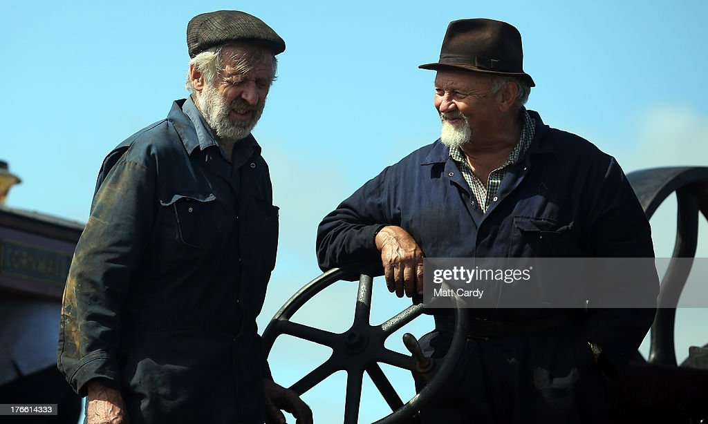 Exhibitors chat as they prepare their steam engines to show at the Cornish Steam and Country Fair at the Stithians Showground on August 16, 2013 near Penryn, England. The annual show, now in 58th year, is one of Cornwall's largest outdoor events and is one of the UK's most popular and respected steam rallies.