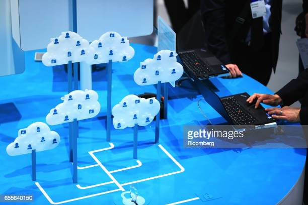 Exhibitors demonstrate iCloud security concepts in a pavilion at the CeBIT 2017 tech fair in Hannover Germany on Monday March 20 2017 Leading edge...