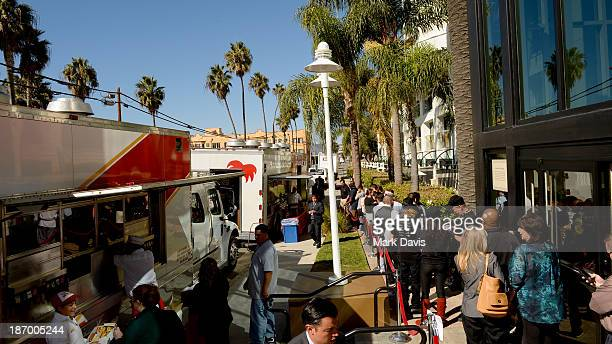 Exhibitors graba a bite to eat from the InNOut truck at the American Film Market at the Loews Santa Monica Beach Hotel on November 5 2013 in Santa...