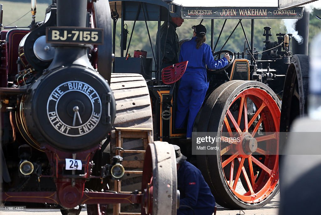 Exhibitors prepare their steam engines to show at the Cornish Steam and Country Fair at the Stithians Showground on August 16, 2013 near Penryn, England. The annual show, now in 58th year, is one of Cornwall's largest outdoor events and is one of the UK's most popular and respected steam rallies.