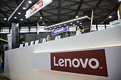 Exhibitors sit behind a counter at the Lenovo Group Ltd booth at the Mobile World Congress Shanghai in Shanghai China on Wednesday June 29 2016 The...