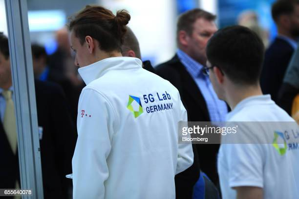 Exhibitors wear 5G Lab clothing promoting 5G connectivity at the CeBIT 2017 tech fair in Hannover Germany on Monday March 20 2017 Leading edge...