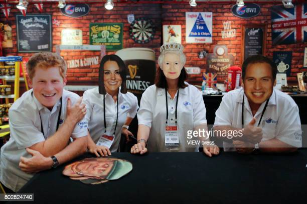 Exhibitors wear royal family mask at the British pavilion as they attend the Annual Summer Fancy Food Show on June 262017 at the Javits Center in New...