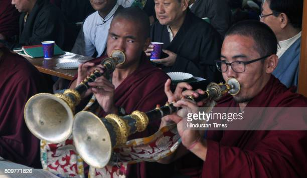 Exile Tibetan Buddhist monks blow ceremonial horns as they celebrate the 82nd birthday of their spiritual leader the Dalai Lama at McLeod Ganj on...