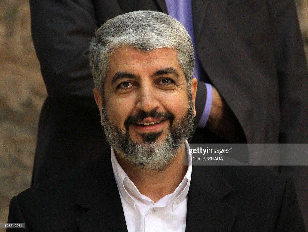 Exiled Hamas chief Khaled Meshaal smiles during a Hamas 'Iftar' diner for the media in Damascus, on August 24, 2010, where he urged the Egyptian and Jordanian leaders to boycott the resumption early next month of direct Israeli-Palestinian talks to be hosted by Washington. The Iftar diner breaks the day long fast from food and water by Muslims during the holy month of Ramadan.