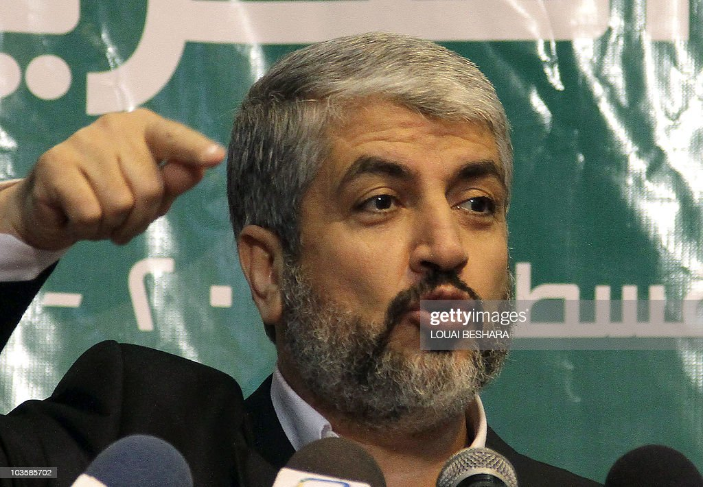 Exiled Hamas chief Khaled Meshaal talks to reporters during a Hamas 'Iftar' diner for the media in Damascus, on August 24, 2010, where he urged the Egyptian and Jordanian leaders to boycott the resumption early next month of direct Israeli-Palestinian talks to be hosted by Washington. The Iftar diner breaks the day long fast from food and water by Muslims during the holy month of Ramadan. AFP PHOTO/ LOUAI BESHARA