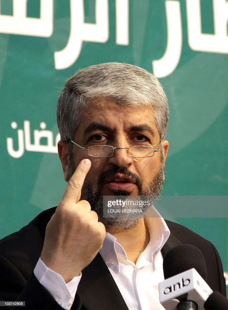 Exiled Hamas chief Khaled Meshaal talks to reporters during a Hamas 'Iftar' diner for the media in Damascus, on August 24, 2010, where he urged the Egyptian and Jordanian leaders to boycott the resumption early next month of direct Israeli-Palestinian talks to be hosted by Washington. The Iftar diner breaks the day long fast from food and water by Muslims during the holy month of Ramadan.