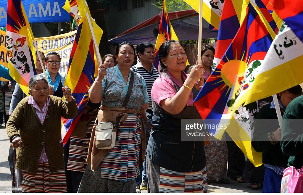 Exiled Tibetan activists hold Tibetan flags and chant anti-China slogans during a protest marking the 55th anniversary of the 1959 Tibetan uprising against Chinese rule in India's capital New Delhi on March 12, 2014. Tibetan anger at Beijing's control simmered for decades and erupted into violent riots against Chinese rule in the Tibet regional capital Lhasa and adjacent areas in March 2008. Since 2009, more than 120 Tibetans have set themselves on fire to protest at China's rule and at least 90 have died.