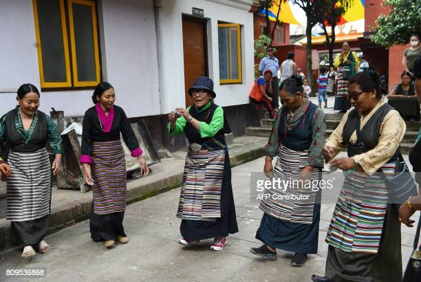 Exiled Tibetan Buddhists perform rituals to mark the birthday of spiritual leader the Dalai Lama at Boudhanath Stupa in the Nepalese capital...