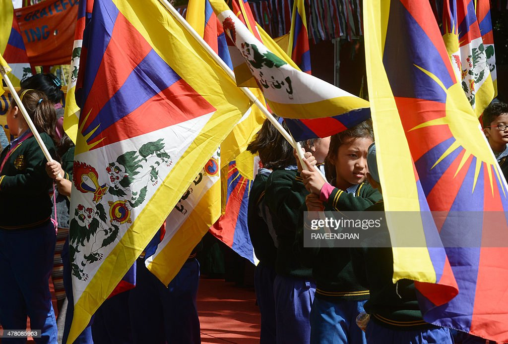 Exiled Tibetan schoolchildren hold Tibetan flags during a protest marking the 55th anniversary of the 1959 Tibetan uprising against Chinese rule in India's capital New Delhi on March 12, 2014. The Tibetan government-in-exile has branded Beijing's 'hardline policy' towards the troubled region a failure and urged China's next leaders to hand greater autonomy to Tibetans. AFP PHOTO/RAVEENDRAN