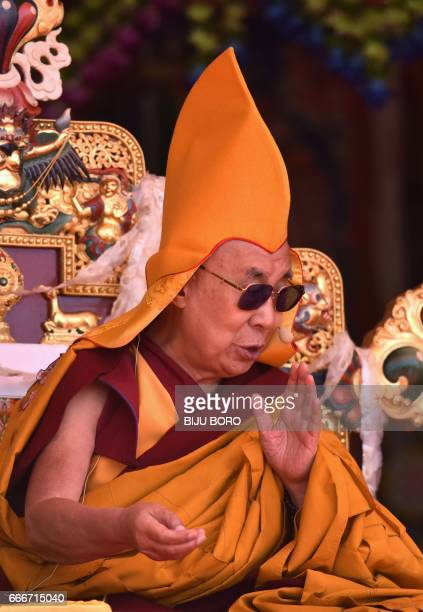 Exiled Tibetan spiritual leader the Dalai Lama delivers teachings to Buddhist followers on the last day of his visit at the Yiga Choezin ground in...