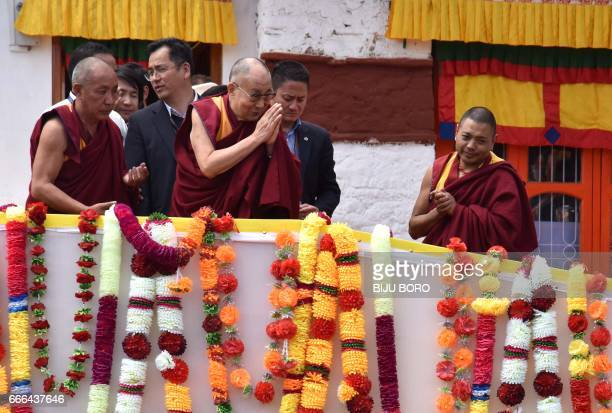 Exiled Tibetan spiritual leader the Dalai Lama gestures to Buddhist followers at Urgelling Monastery the birthplace of the 6th Dalai Lama in the...