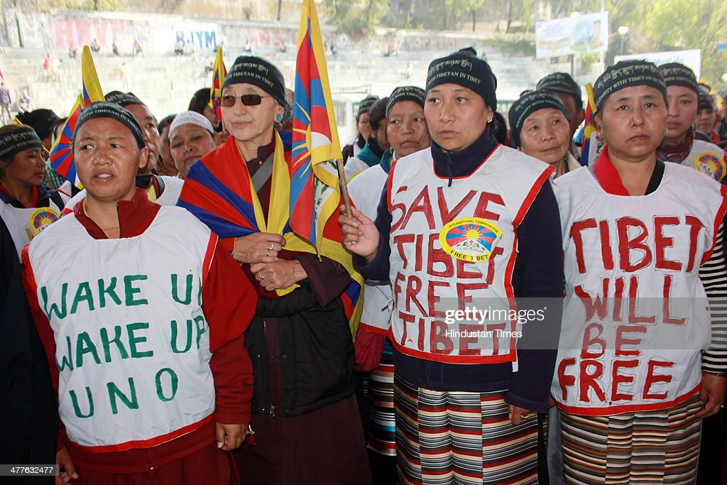 Exiled Tibetan women holding procession to mark the 55th anniversary of the failed uprising in the Tibetan capital Lhasa in 1959 on March 10, 2014 in Mandi, India. The group demonstrated in support of the 127 people who have self-immolated to protest China's policy towards Tibet and pressed China to allow independent media into Tibet.