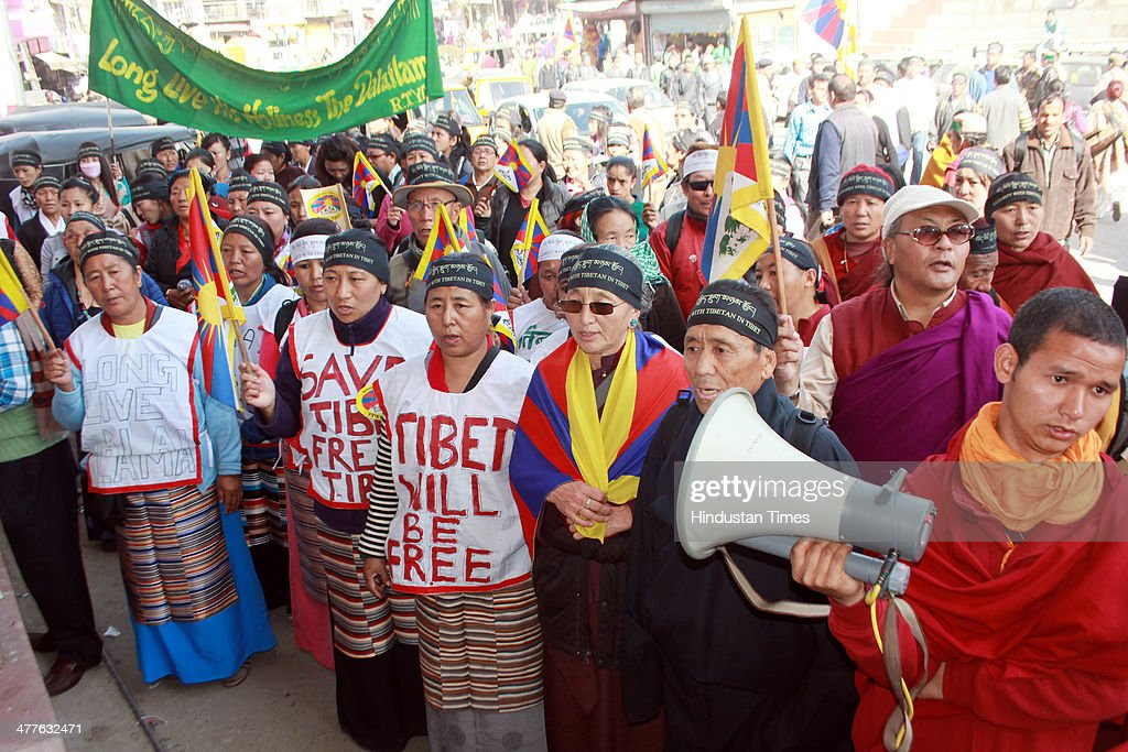 Exiled Tibetans holding procession to mark the 55th anniversary of the failed uprising in the Tibetan capital Lhasa in 1959 on March 10, 2014 in Mandi, India. The group demonstrated in support of the 127 people who have self-immolated to protest China's policy towards Tibet and pressed China to allow independent media into Tibet.
