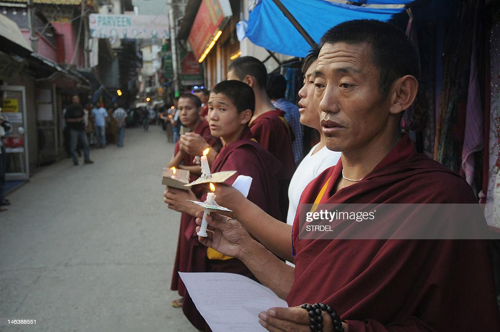 Exiled Tibetans monks chant prayers during a rally to stand in solidarity with Tamdin Thar, who burned himself to death to protest against the Chinese rule in Tibet, in McLeod Ganj on June 15 2012. Chinese authorities have said they were investigating the death of a person by self-immolation in a Tibetan area of northwestern Qinghai province, where several Tibetans have in the past year set themselves on fire in protest.