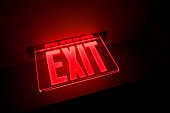 Exit sign illuminated, close-up, low angle view