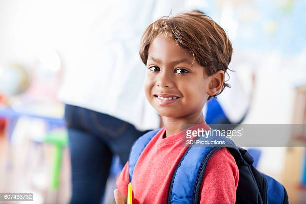 Exited kindergartner on his first day of school