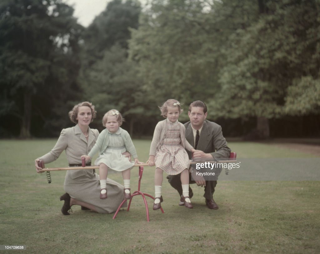 Ex-King Michael of Romania in the garden of his home, Ayot House in Hertfordshire, with his wife, Princess Anne of Bourbon-Parma and their daughters Margarita and Elena on September 02, 1953.