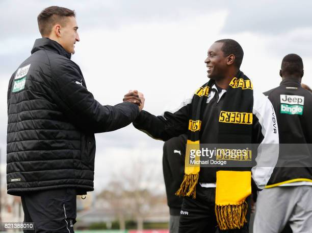 ExLiverpool and Manchester United stars including Steve McManaman David James Emile Heskey Louis Saha and Jose Kleberson join Richmond Tigers players...