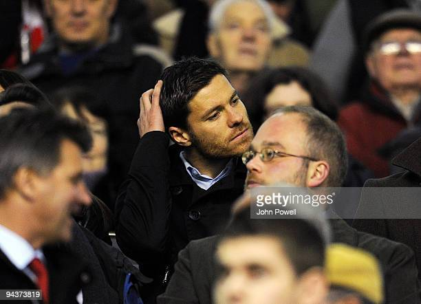 ExLiverpool player Xabi Alonso sits in the crowd during the Barclays Premier League match between Liverpool and Arsenal at Anfield on December 13...